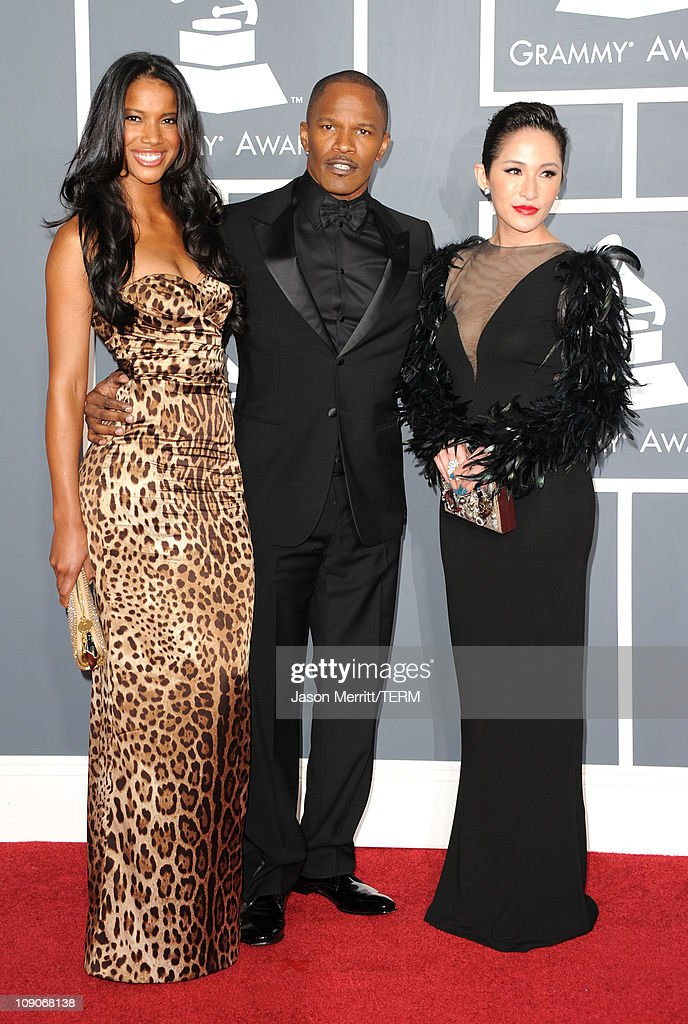 Actor <a gi-track='captionPersonalityLinkClicked' href=/galleries/search?phrase=Jamie+Foxx&family=editorial&specificpeople=201715 ng-click='$event.stopPropagation()'>Jamie Foxx</a> (C) and guests arrive at The 53rd Annual GRAMMY Awards held at Staples Center on February 13, 2011 in Los Angeles, California.