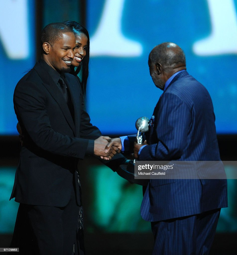 Actor Jamie Foxx and Hall of Fame Winner Clarence Avant onstage during the 41st NAACP Image awards held at The Shrine Auditorium on February 26, 2010 in Los Angeles, California.