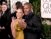 Actor Jamie Foxx and his girlfriend Leila Arcieri arrive to the 62nd Annual Golden Globe Awards at the Beverly Hilton Hotel January 16 2005 in...