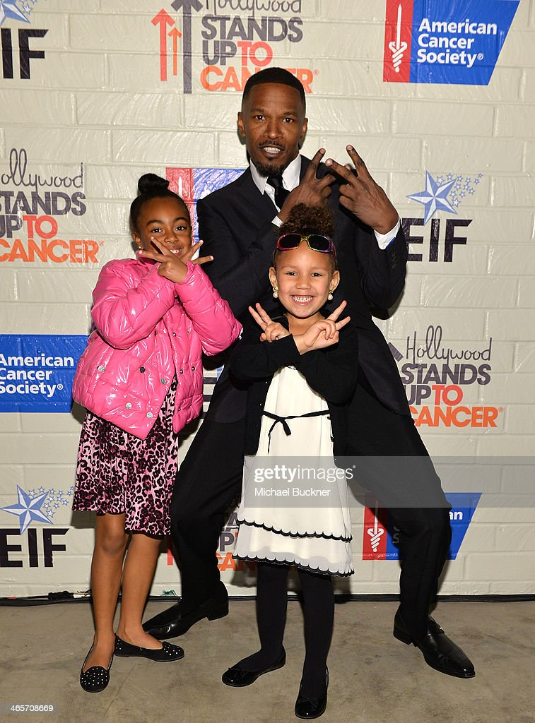 Actor <a gi-track='captionPersonalityLinkClicked' href=/galleries/search?phrase=Jamie+Foxx&family=editorial&specificpeople=201715 ng-click='$event.stopPropagation()'>Jamie Foxx</a> (R), Annalise Bishop and guest attend Hollywood Stands Up To Cancer Event with contributors American Cancer Society and Bristol Myers Squibb hosted by Jim Toth and Reese Witherspoon and the Entertainment Industry Foundation on Tuesday, January 28, 2014 in Culver City, California.