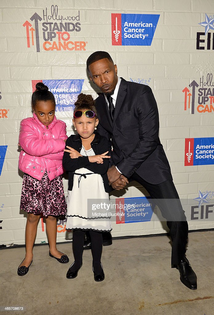 Actor <a gi-track='captionPersonalityLinkClicked' href=/galleries/search?phrase=Jamie+Foxx&family=editorial&specificpeople=201715 ng-click='$event.stopPropagation()'>Jamie Foxx</a> (R), <a gi-track='captionPersonalityLinkClicked' href=/galleries/search?phrase=Annalise+Bishop&family=editorial&specificpeople=10846979 ng-click='$event.stopPropagation()'>Annalise Bishop</a> and guest attend Hollywood Stands Up To Cancer Event with contributors American Cancer Society and Bristol Myers Squibb hosted by Jim Toth and Reese Witherspoon and the Entertainment Industry Foundation on Tuesday, January 28, 2014 in Culver City, California.