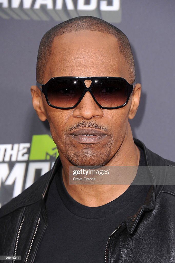 Actor <a gi-track='captionPersonalityLinkClicked' href=/galleries/search?phrase=Jamie+Foxx&family=editorial&specificpeople=201715 ng-click='$event.stopPropagation()'>Jamie Foxx</a> arrives at the 2013 MTV Movie Awards at Sony Pictures Studios on April 14, 2013 in Culver City, California.