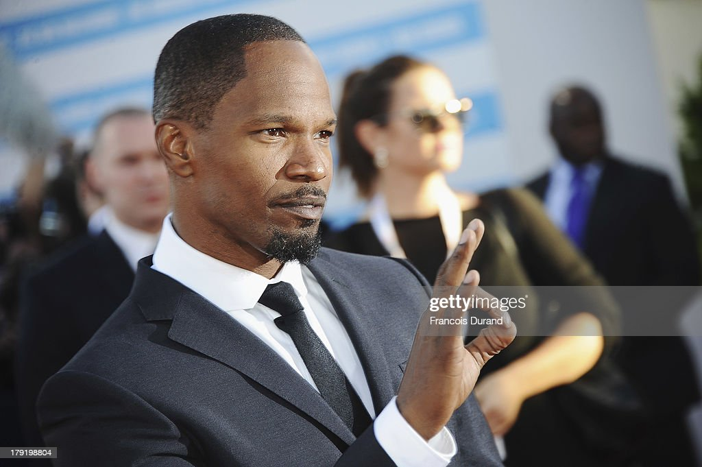 US actor <a gi-track='captionPersonalityLinkClicked' href=/galleries/search?phrase=Jamie+Foxx&family=editorial&specificpeople=201715 ng-click='$event.stopPropagation()'>Jamie Foxx</a> arrives at the premiere of the movie 'White House Down' during the 39th Deauville American film festival on September 1, 2013 in Deauville, France.