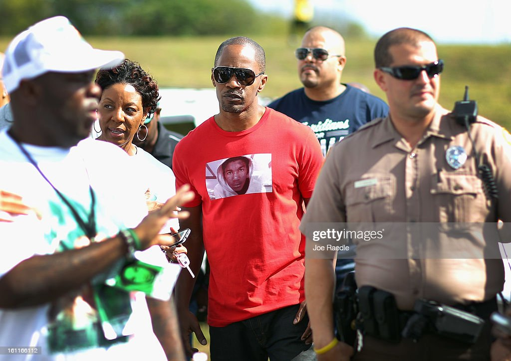 Actor <a gi-track='captionPersonalityLinkClicked' href=/galleries/search?phrase=Jamie+Foxx&family=editorial&specificpeople=201715 ng-click='$event.stopPropagation()'>Jamie Foxx</a> arrives for the 'March for Peace' at Ives Estate Park in honor of , Trayvon Martin, on February 9, 2013 in Miami, Florida. Trayvon Martin was killed by George Zimmerman on February 26, 2012 while Zimmerman was on neighborhood watch patrol in the gated community of The Retreat at Twin Lakes in Sanford, Florida.