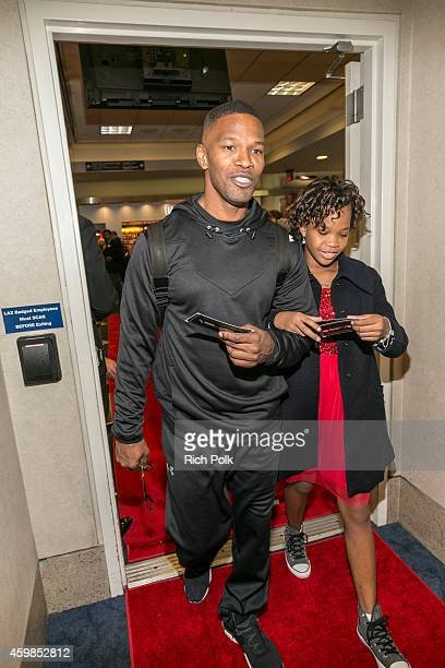 Actor Jamie Foxx escorts Quvenzhané Wallis to the plane for the MasterCard takes Priceless Surprises to new heights with a screening of the new...