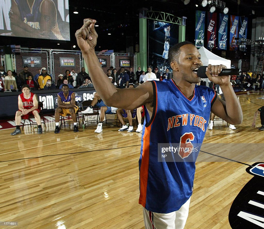 Actor Jamie Foxx gets the crowd into the ATT Celebrity Shootout during the NBA All Star 2003 Jam Session on February 8 2003 in Atlanta Georga