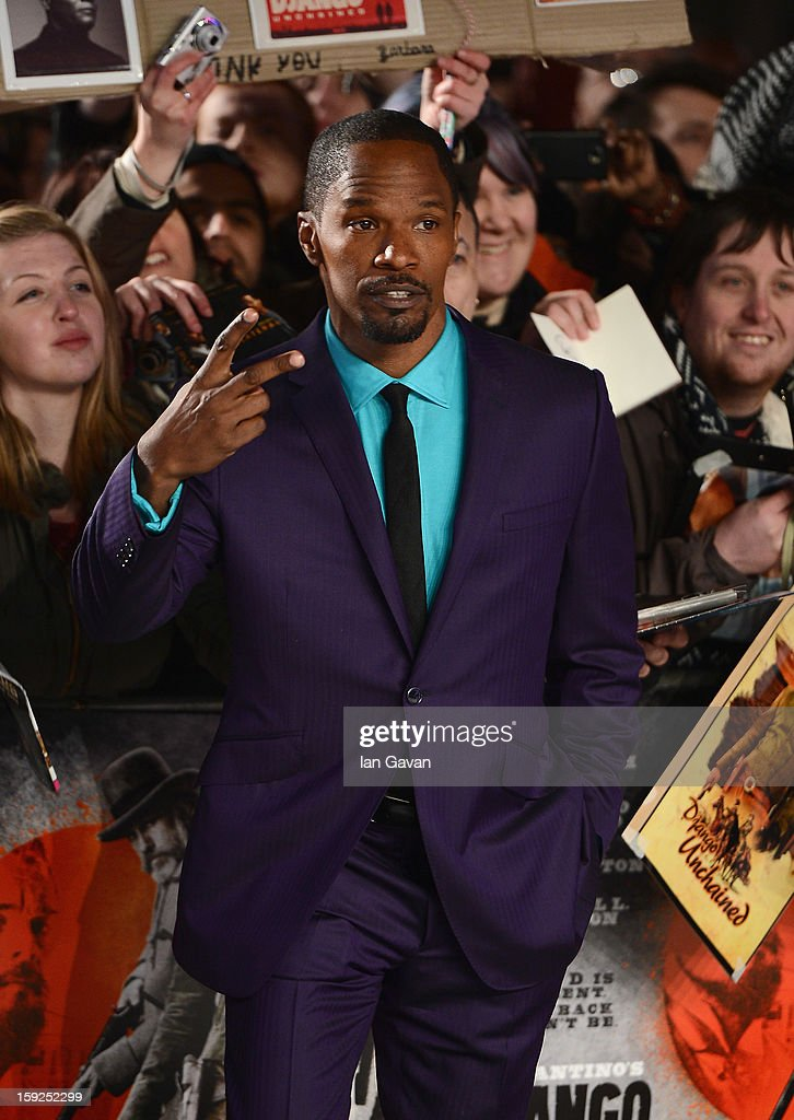 Actor Jamie Foxx poses with fans as he attends the UK Premiere of 'Django Unchained' at the Empire Leicester Square on January 10, 2013 in London, England.