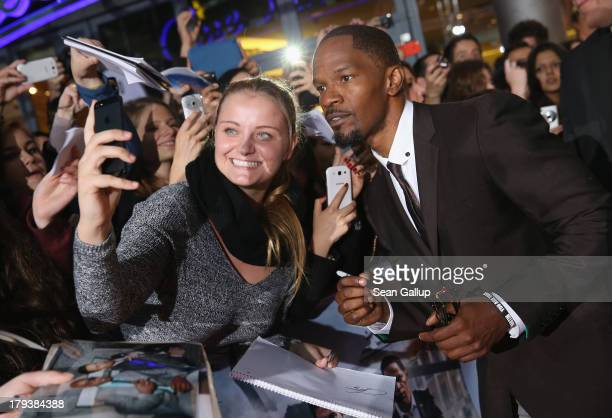 Actor Jamie Foxx signs autographs for fans as he attends the 'White House Down' Germany premiere at CineStar on September 2 2013 in Berlin Germany