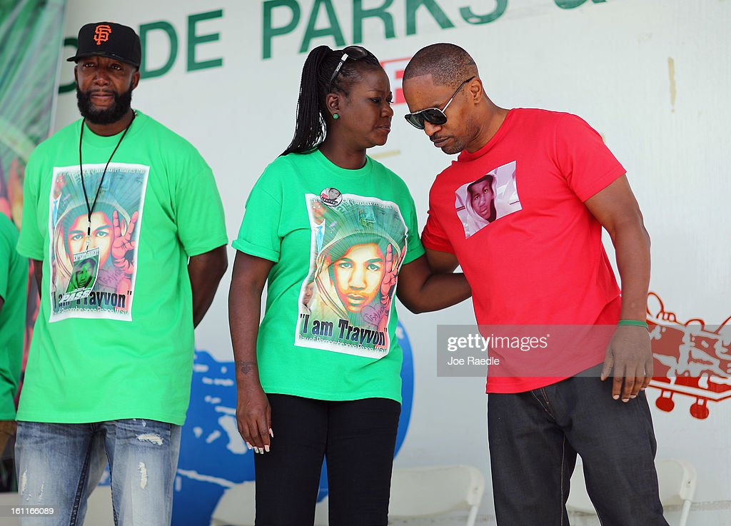 Actor Jamie Foxx (R) stands with Sybrina Fulton (C) and Tracy Martin during the 'March for Peace' at Ives Estate Park in honor of their late son, Trayvon Martin, on February 9, 2013 in Miami, Florida. Trayvon Martin was killed by George Zimmerman on February 26, 2012 while Zimmerman was on neighborhood watch patrol in the gated community of The Retreat at Twin Lakes in Sanford, Florida.
