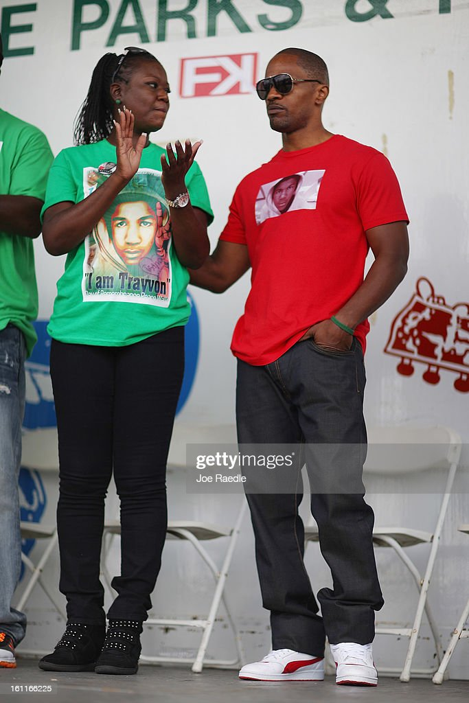 Actor Jamie Foxx stands with Sybrina Fulton during the 'March for Peace' at Ives Estate Park in honor of her late son, Trayvon Martin, on February 9, 2013 in Miami, Florida. Trayvon Martin was killed by George Zimmerman on February 26, 2012 while Zimmerman was on neighborhood watch patrol in the gated community of The Retreat at Twin Lakes in Sanford, Florida.