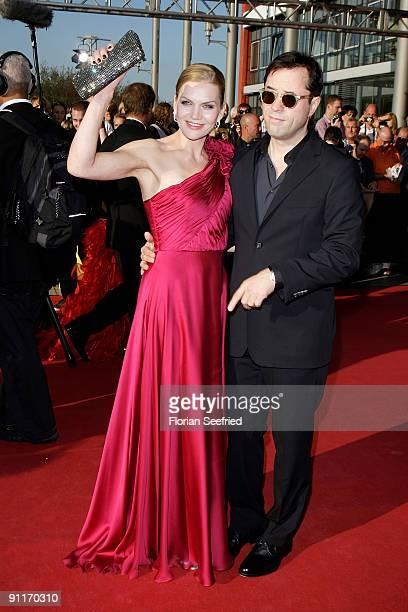 Actor Jan Josef Liefers and wife actress Anna LoosLiefers arrive for the German TV Award 2009 at the Coloneum on September 26 2009 in Cologne Germany