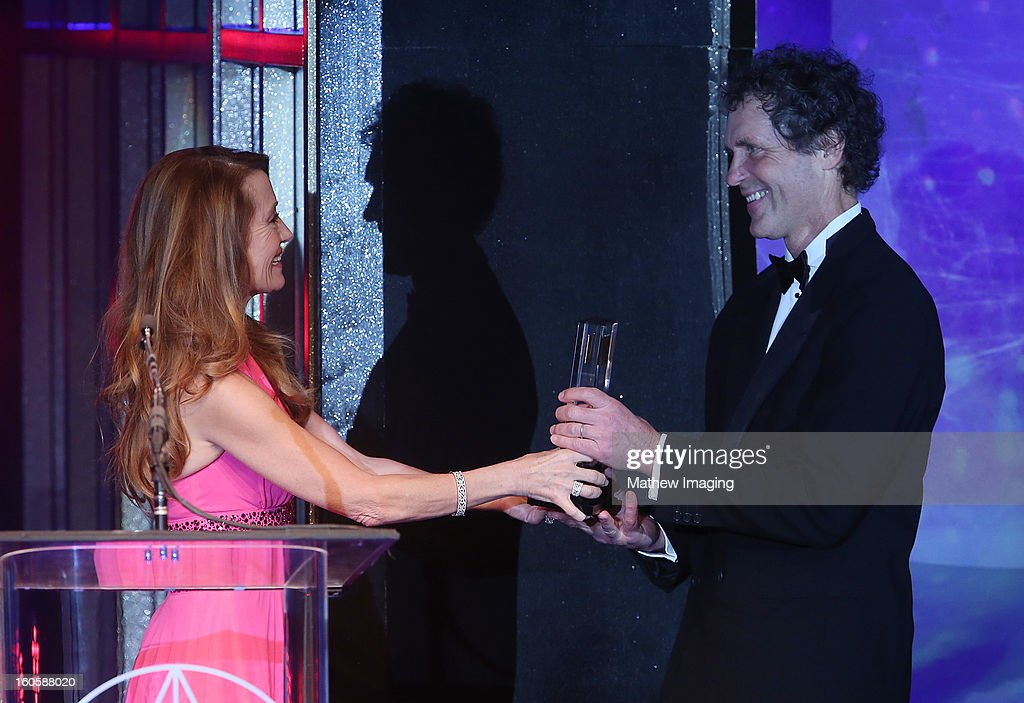 Actor Jane Seymour presents the Excellence in Production Design for a Contemporary Feature Film 2012 Award for SKYFALL to Production Designer Dennis Gassner at The 17th Annual Art Directors Guild Awards, held at the Beverly Hilton Hotel on February 2, 2013 in Beverly Hills, California.