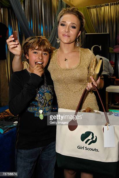 Actor Jansen and actress Hayden Panettiere pose with the Girl Scouts display in the Distinctive Assets gift lounge during the 20th annual Kid's...