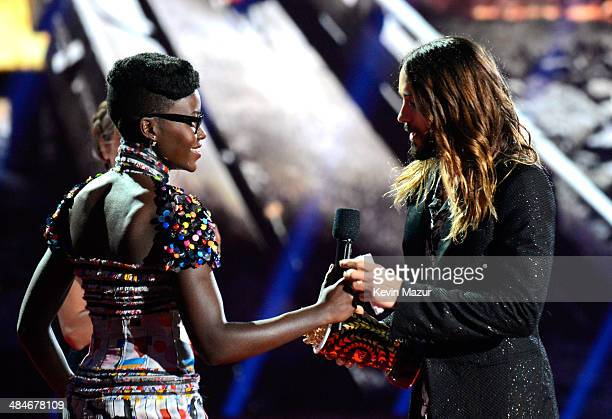 Actor Jared Leto accepts the Best OnScreen Transformation award for 'Dallas Buyers Club' from actress Lupita Nyong'o onstage at the 2014 MTV Movie...