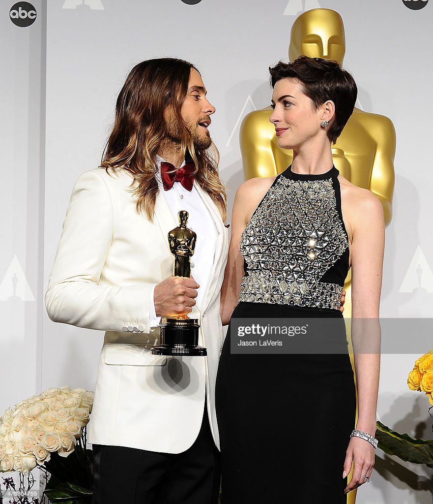 Actor Jared Leto and actress Anne Hathaway pose in the press room at the 86th annual Academy Awards at Dolby Theatre on March 2, 2014 in Hollywood, California.
