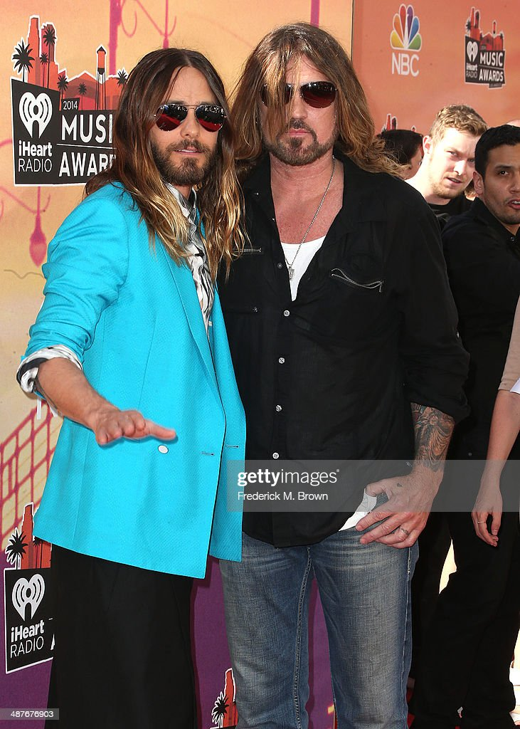 Actor Jared Leto (L) and singer Billy Ray Cyrus attend the 2014 iHeartRadio Music Awards at The Shrine Auditorium on May 1, 2014 in Los Angeles, California.