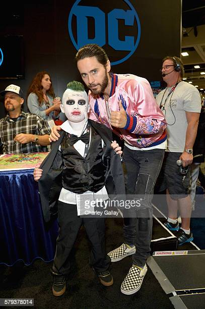 Actor Jared Leto from the cast of Suicide Squad film poses with a cosplayer in DC's 2016 ComicCon booth at San Diego Convention Center on July 23...