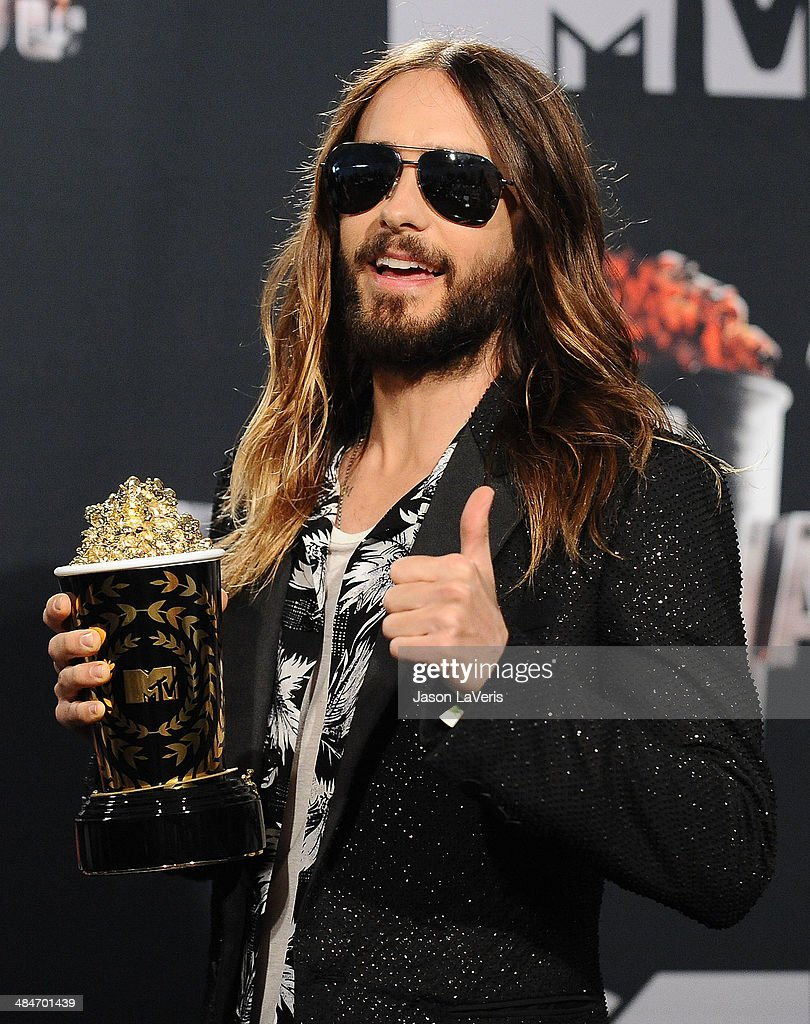 Actor <a gi-track='captionPersonalityLinkClicked' href=/galleries/search?phrase=Jared+Leto&family=editorial&specificpeople=214764 ng-click='$event.stopPropagation()'>Jared Leto</a> poses in the press room at the 2014 MTV Movie Awards at Nokia Theatre L.A. Live on April 13, 2014 in Los Angeles, California.