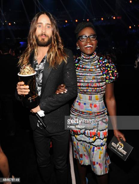Actor Jared Leto winner of the Best OnScreen Transformation award for 'Dallas Buyers Club' and actress Lupita Nyong'o attend the 2014 MTV Movie...