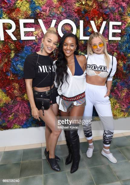 Actor Jasmine Sanders stylist Brittany Hampton and blogger Danielle Bernstein attend the #REVOLVEfestival at Coachella with Moet Chandon on April 16...