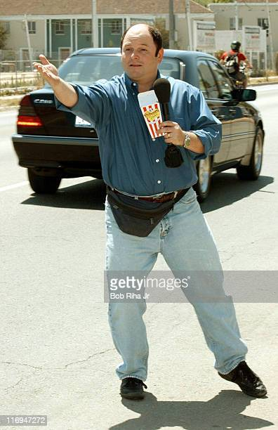 Actor Jason Alexander tries to get motorists to pull over and try KFC's Popcorn Chicken along 3rd Street in Los Angeles Calif June 14 during a...