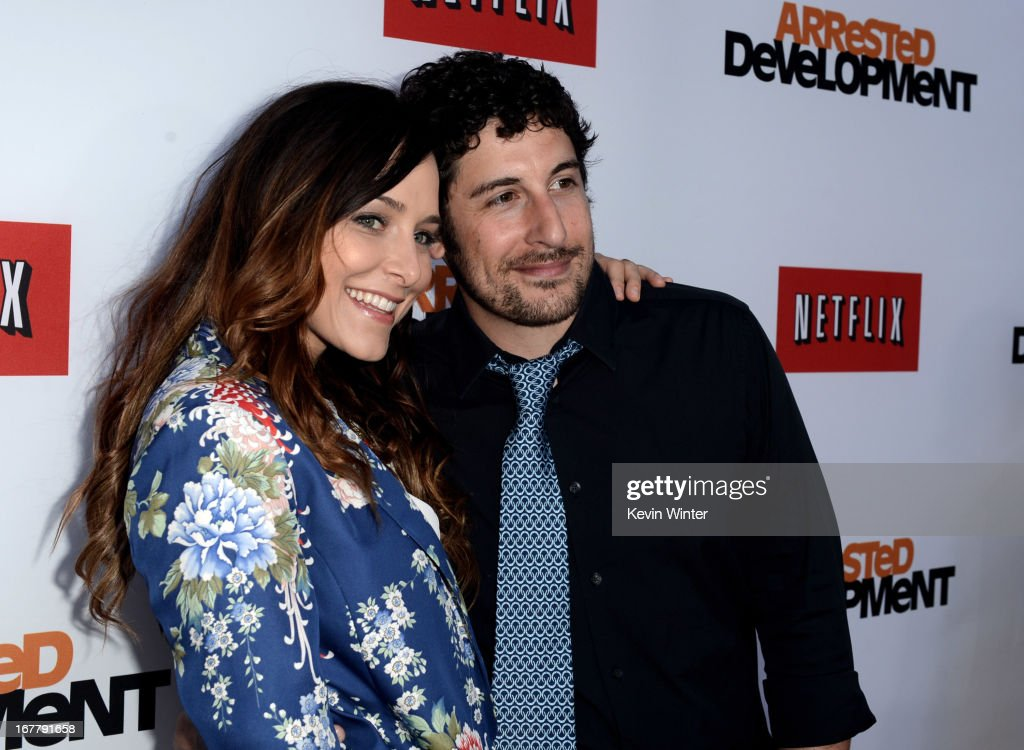 Actor <a gi-track='captionPersonalityLinkClicked' href=/galleries/search?phrase=Jason+Biggs+-+Actor&family=editorial&specificpeople=210701 ng-click='$event.stopPropagation()'>Jason Biggs</a> (R) and his wife <a gi-track='captionPersonalityLinkClicked' href=/galleries/search?phrase=Jenny+Mollen&family=editorial&specificpeople=599177 ng-click='$event.stopPropagation()'>Jenny Mollen</a> arrive at the premiere of Netflix's 'Arrested Development' Season 4 at the Chinese Theatre on April 29, 2013 in Los Angeles, California.