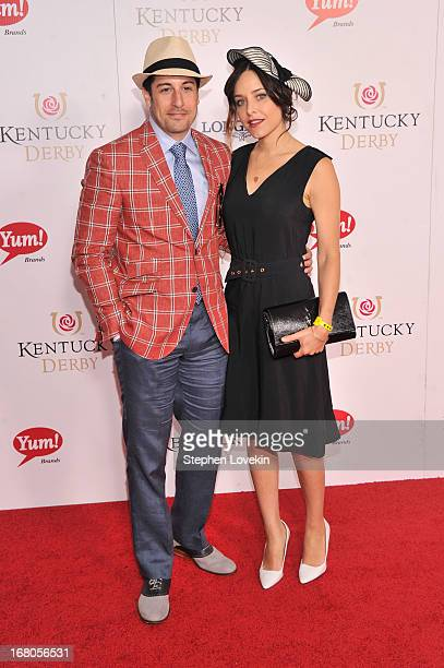 Actor Jason Biggs and Jenny Mollen attend the 139th Kentucky Derby at Churchill Downs on May 4 2013 in Louisville Kentucky