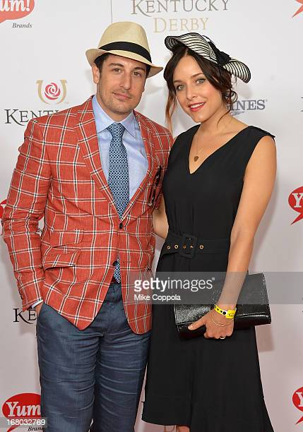 Actor Jason Biggs and Jenny Mollen celebrate the 139th Kentucky Derby with Moet Chandon at Churchill Downs on May 4 2013 in Louisville Kentucky