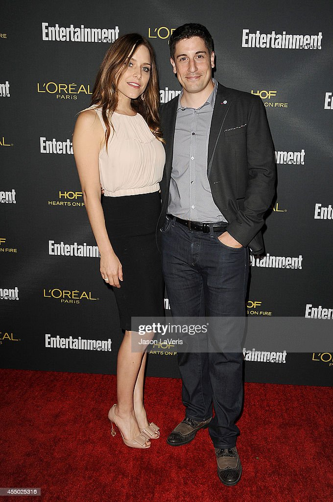 Actor <a gi-track='captionPersonalityLinkClicked' href=/galleries/search?phrase=Jason+Biggs+-+Actor&family=editorial&specificpeople=210701 ng-click='$event.stopPropagation()'>Jason Biggs</a> (R) and wife <a gi-track='captionPersonalityLinkClicked' href=/galleries/search?phrase=Jenny+Mollen&family=editorial&specificpeople=599177 ng-click='$event.stopPropagation()'>Jenny Mollen</a> attend the 2014 Entertainment Weekly pre-Emmy party at Fig & Olive Melrose Place on August 23, 2014 in West Hollywood, California.