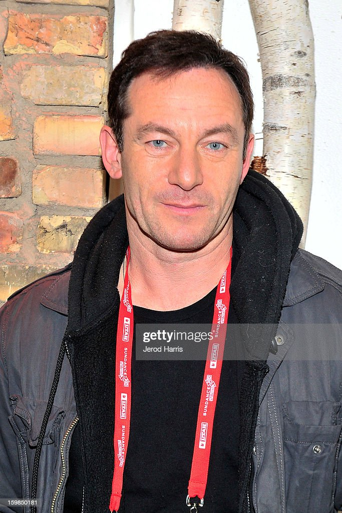 Actor Jason Isaacs warms up at the McDonald's McCafe at Sundance on January 21, 2013 in Park City, Utah.