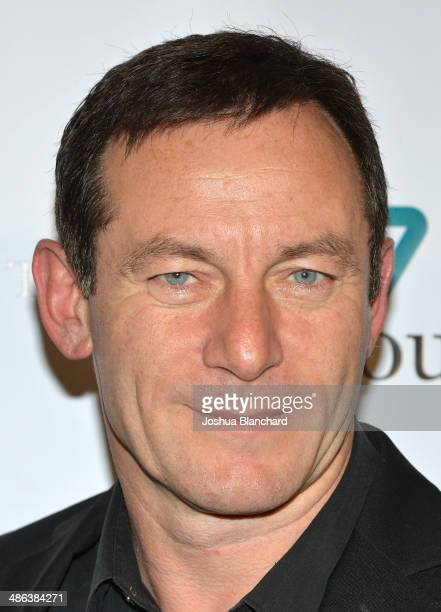 Actor Jason Issacs arrives at the 17th Annual Teddy Bear Ball at The Beverly Hilton Hotel on April 23 2014 in Beverly Hills California