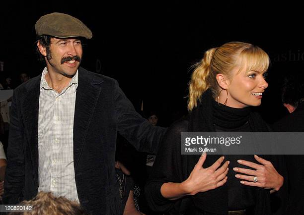 Actor Jason Lee and actress Jaime Pressly mingle backstage at Whitley Kros fashion show at the Mercedes Benz Fashion Week at Smashbox Studios on...