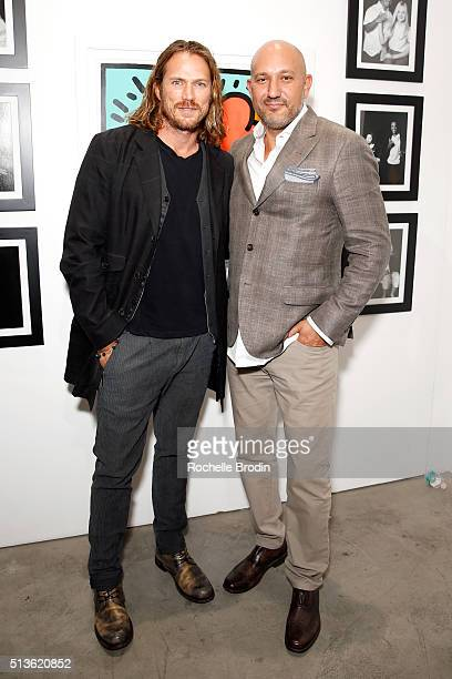 Actor Jason Lewis and De Re Gallery owner Steph Sebbag attend Best Buddies 'The Art of Friendship' Benefit Photo Auction hosted by De Re Gallery on...