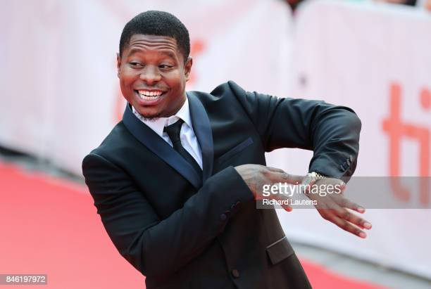 TORONTO ON SEPTEMBER 12 Actor Jason Mitchell checks the time MUDBOUND had a showing at Roy Thomson Hall for TIFF On the red carpet the expected...