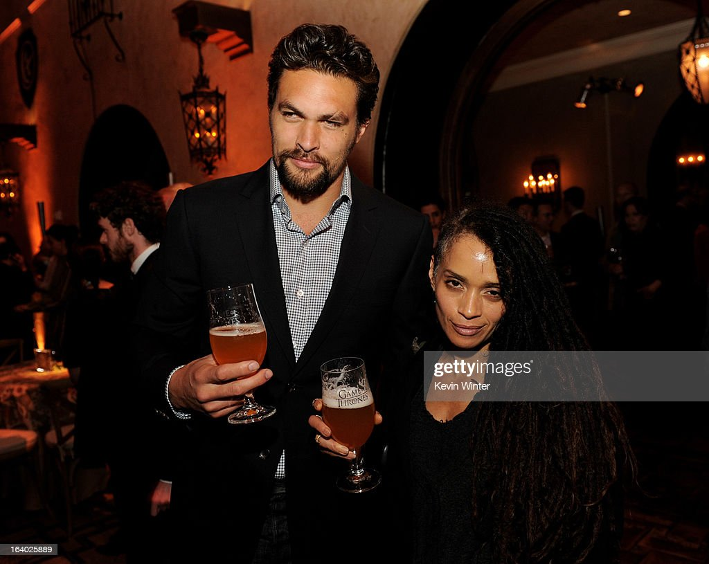 Actor Jason Momoa (L) and his wife actress Lisa Bonet pose at the after party for the premiere of HBO's 'Game Of Thrones' at the Roosevelt Hotel on March 18, 2013 in Los Angeles, California.