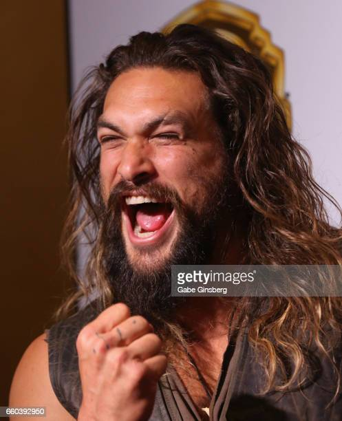 Actor Jason Momoa yells during the Warner Bros Pictures presentation at CinemaCon at The Colosseum at Caesars Palace on March 29 2017 in Las Vegas...