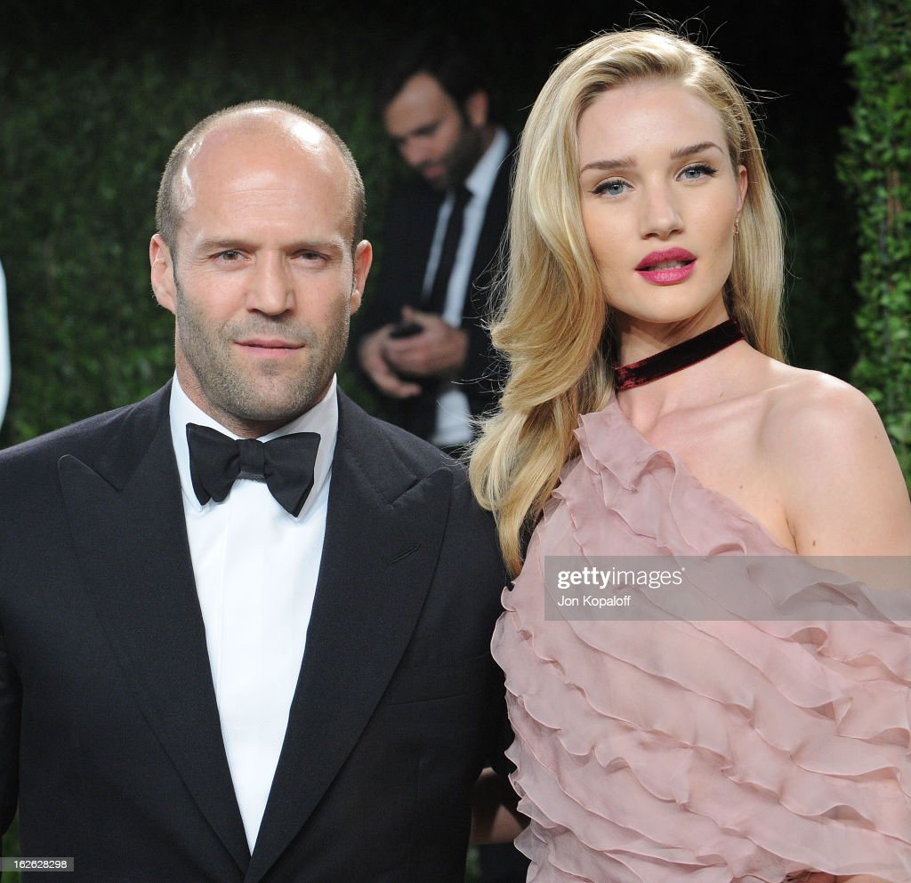 Actor Jason Statham and actress Rosie Huntington-Whiteley attend the 2013 Vanity Fair Oscar party at Sunset Tower on February 24, 2013 in West Hollywood, California.