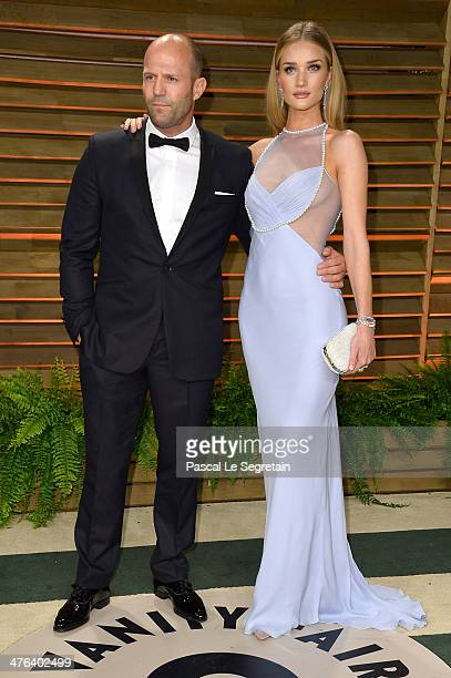 Actor Jason Statham and model Rosie HuntingtonWhiteley attend the 2014 Vanity Fair Oscar Party hosted by Graydon Carter on March 2 2014 in West...