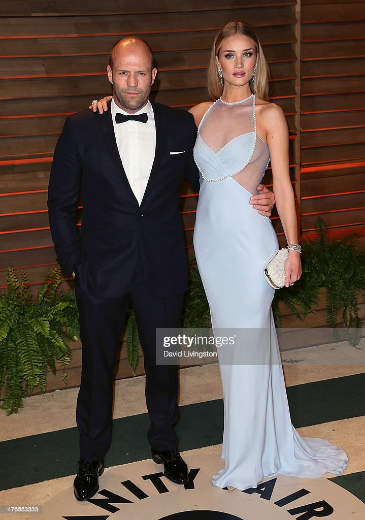 Actor <a gi-track='captionPersonalityLinkClicked' href=/galleries/search?phrase=Jason+Statham&family=editorial&specificpeople=217567 ng-click='$event.stopPropagation()'>Jason Statham</a> (L) and model <a gi-track='captionPersonalityLinkClicked' href=/galleries/search?phrase=Rosie+Huntington-Whiteley&family=editorial&specificpeople=2244343 ng-click='$event.stopPropagation()'>Rosie Huntington-Whiteley</a> attend the 2014 Vanity Fair Oscar Party hosted by Graydon Carter on March 2, 2014 in West Hollywood, California.