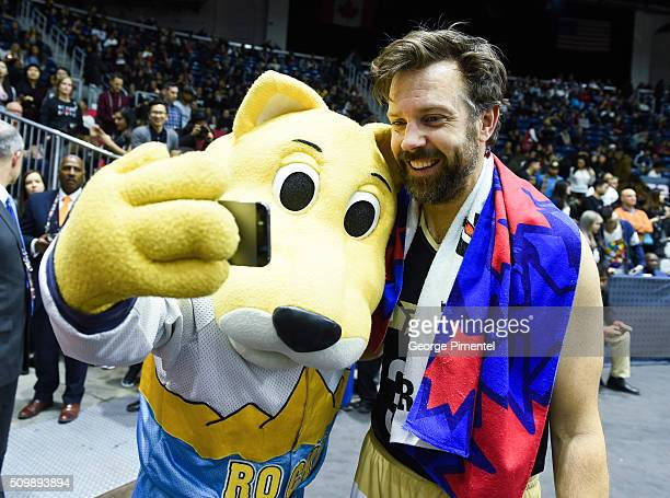 Actor Jason Sudeikis takes a selfie with Denver Nuggets mascot Rocky the Mountain Lion during the 2016 NBA AllStar Celebrity Game at Ricoh Coliseum...