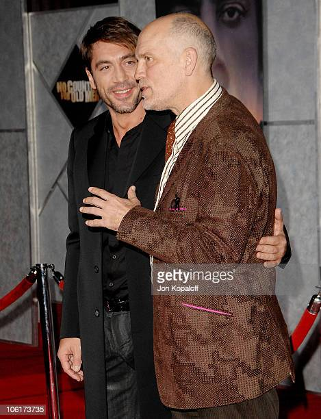 Actor Javier Bardem and actor John Malkovich arrive at the premiere of Miramax Films' 'No Country For Old Men' held at the El Capitan Theater on...