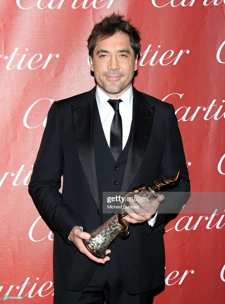 Actor <a gi-track='captionPersonalityLinkClicked' href=/galleries/search?phrase=Javier+Bardem&family=editorial&specificpeople=209334 ng-click='$event.stopPropagation()'>Javier Bardem</a> poses backstage with his International Star Award during the 22nd Annual Palm Springs International Film Festival Awards Gala at the Palm Springs Convention Center on January 8, 2011 in Palm Springs, California.