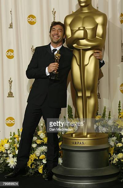 Actor Javier Bardem poses with his award for Best Performance by an Actor in a Supporting Role in the press room during The 80th Annual Academy...