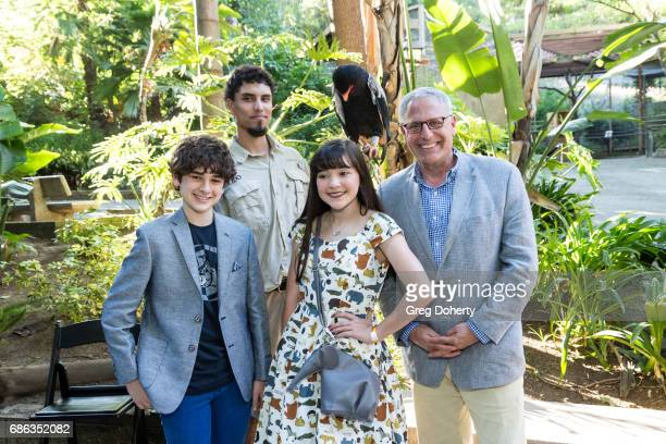 Actor Jax Malcolm Animal Handler Dmetri Domerick Actress Chloe Noelle and National Geographic President and CEO Gary E Knell attend the 50th...