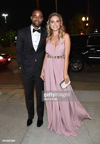 Actor Jay Ellis and model Nina Senicar attend amfAR's Inspiration Gala Los Angeles at Milk Studios on October 29 2015 in Hollywood California