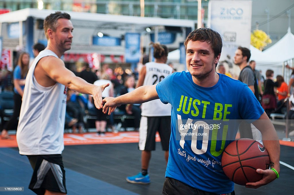 Actor Jay Harrington (L) and Josh Hutcherson attend the 5th annual Nike basketball 3ON3 tournament presented by NBC4 southern california held at L.A. LIVE on August 9, 2013 in Los Angeles, California.