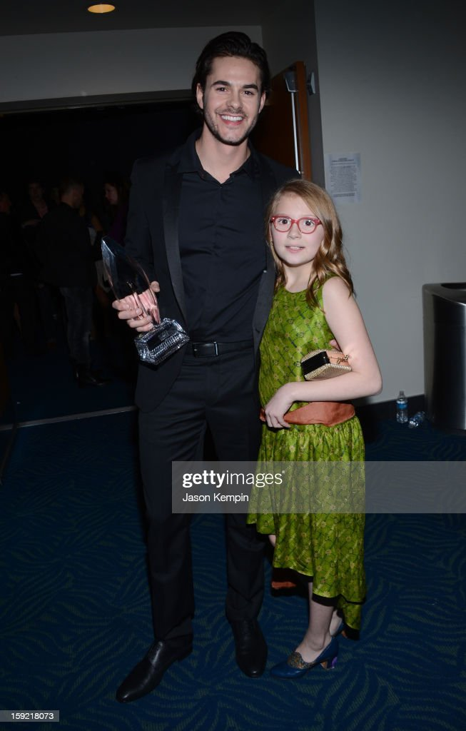 Actor Jayson Blair (L) and actress Bebe Wood hold the award for Favorite New TV Comedy backstage at the 39th Annual People's Choice Awards at Nokia Theatre L.A. Live on January 9, 2013 in Los Angeles, California.