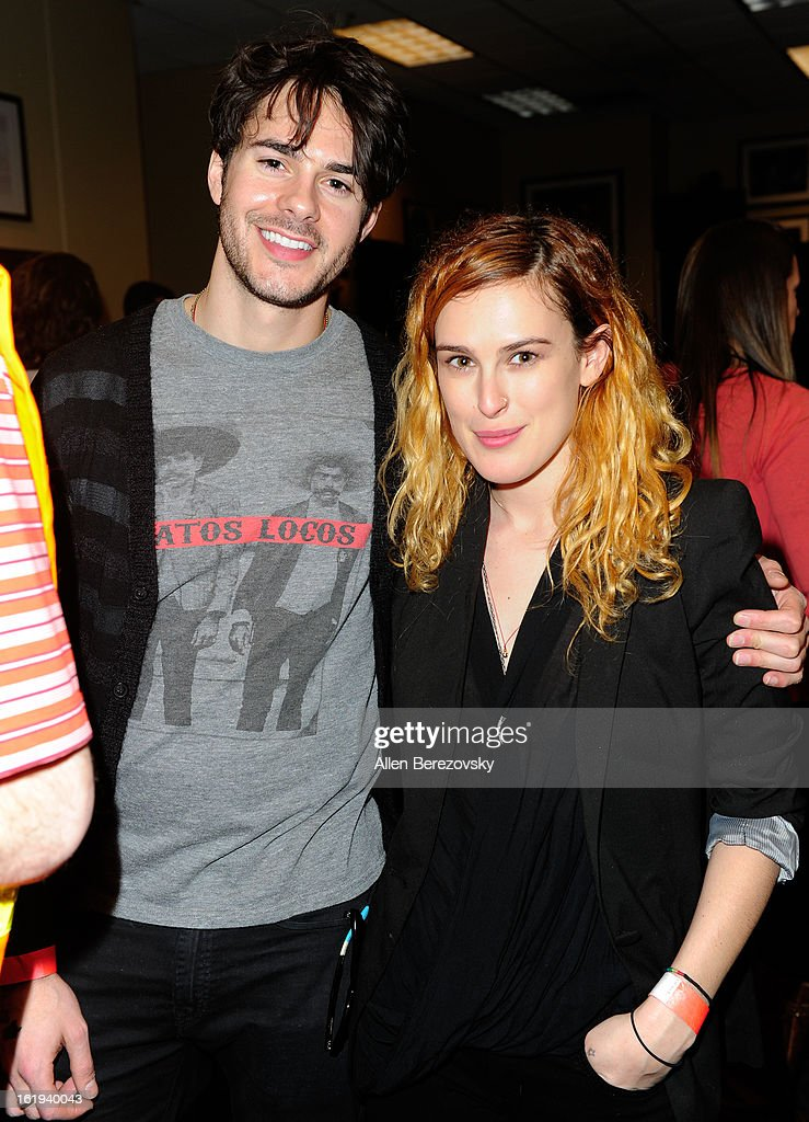 Actor Jayson Blair and actress Rumer Willis attend the Harlem Globetrotters 'You Write The Rules' 2013 tour game at Staples Center on February 17, 2013 in Los Angeles, California.