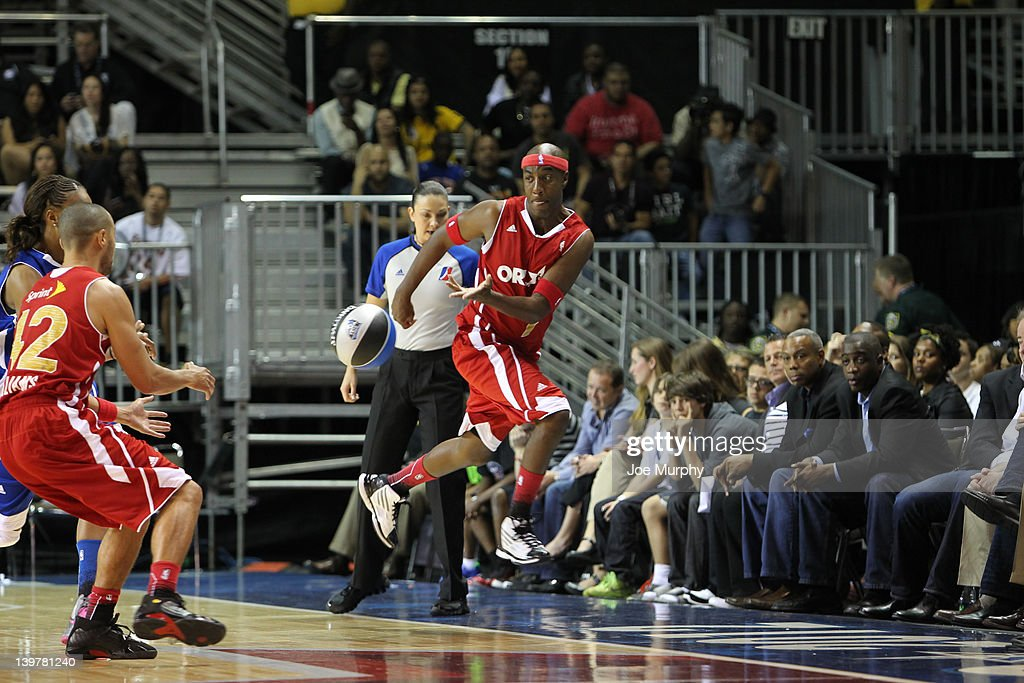 Actor J.B. Smoove of the West team passes the ball to Actor Jesse Williams of the West team during the Sprint All-Star Celebrity Game on center court at Jam Session during the NBA All-Star Weekend on February 24, 2012 at the Orange County Convention Center in Orlando, Florida.
