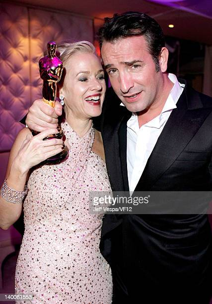 Actor Jean Dujardin and actress Penelope Ann Miller pose with his award for Best Actor for 'The Artist' at the 2012 Vanity Fair Oscar Party Hosted By...